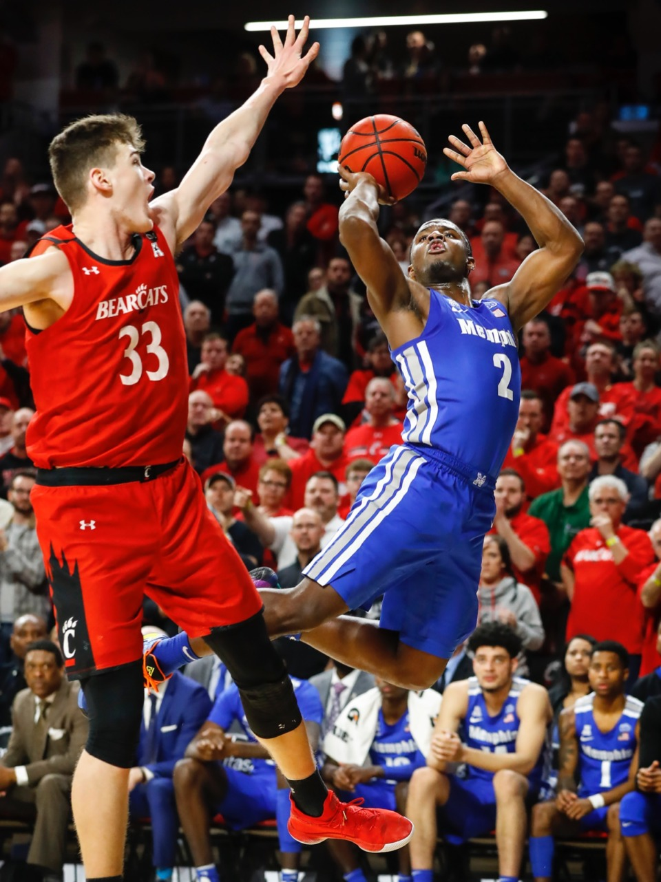 <strong>Memphis guard Alex Lomax (right) drives the lane against Cincinnati's Chris Vogt (left) Thursday, Feb. 13, 2020.</strong> (Mark Weber/Daily Memphian)