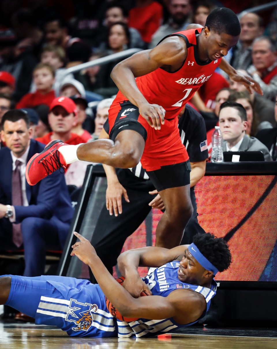 <strong>Cincinnati defender Keith Williams (top) jumps over Memphis forward Malcolm Dandridge (bottom) while going for a loose ball Thursday, Feb. 13, 2020. (Mark Weber/Daily Memphian)</strong>