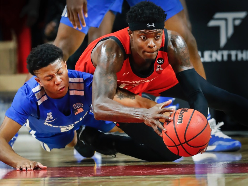 <strong>Memphis defender Boogie Ellis (left) battles Cincinnati forward Tre Scott (right) for a loose ball Thursday, Feb. 13, 2020.</strong> (Mark Weber/Daily Memphian)