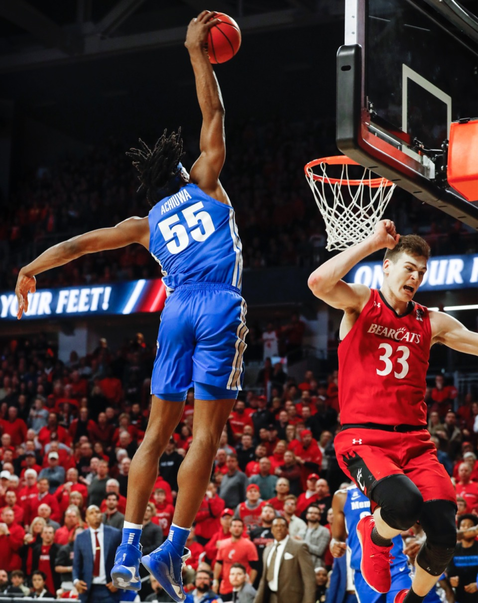 <strong>Memphis forward Precious Achiuwa (left) dunks over Cincinnati defender Chris Vogt (right) Thursday, Feb. 13, 2020.</strong> (Mark Weber/Daily Memphian)