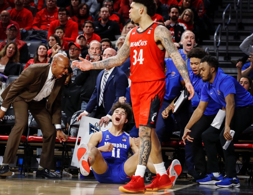 <strong>Memphis guard Lester Quinones (bottom) celebrates a made 3-pointer after being fouled by Cincinnati's Jarron Cumberland (top) Thursday, Feb. 13, 2020.</strong> (Mark Weber/Daily Memphian)