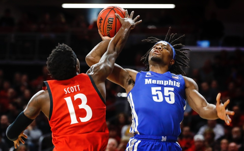 <strong>Memphis forward Precious Achiuwa (right) drives the lane against Cincinnati's Tre Scott (left) Thursday, Feb. 13, 2020.</strong> (Mark Weber/Daily Memphian)