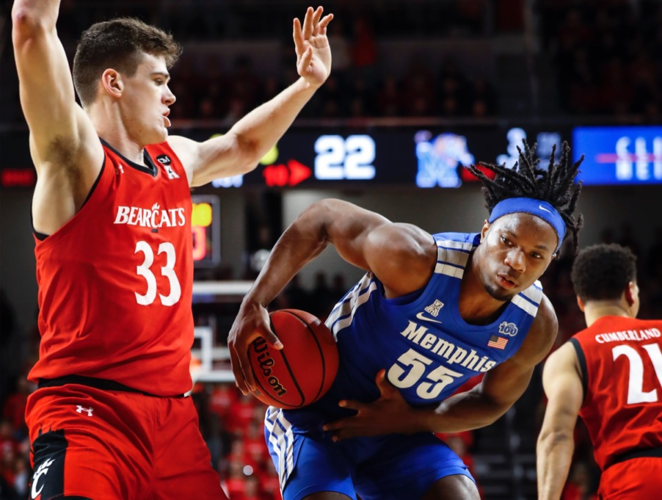 <strong>Memphis forward Precious Achiuwa (right) drives the lane against Cincinnati's Chris Vogt (left) Thursday, Feb. 13, 2020.</strong> (Mark Weber/Daily Memphian)