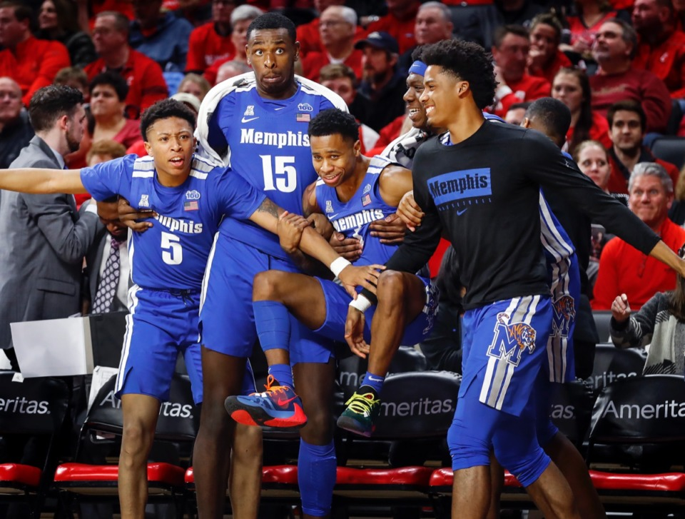 <strong>Memphis teammates (left to right) Boogie Ellis, Lance Thomas, Tyler Harris, Malcolm Dandridge and Jayden Hardaway celebrate a Precious Achiuwa (not pictured) dunk against Cincinnati Thursday, Feb. 13, 2020.</strong> (Mark Weber/Daily Memphian)
