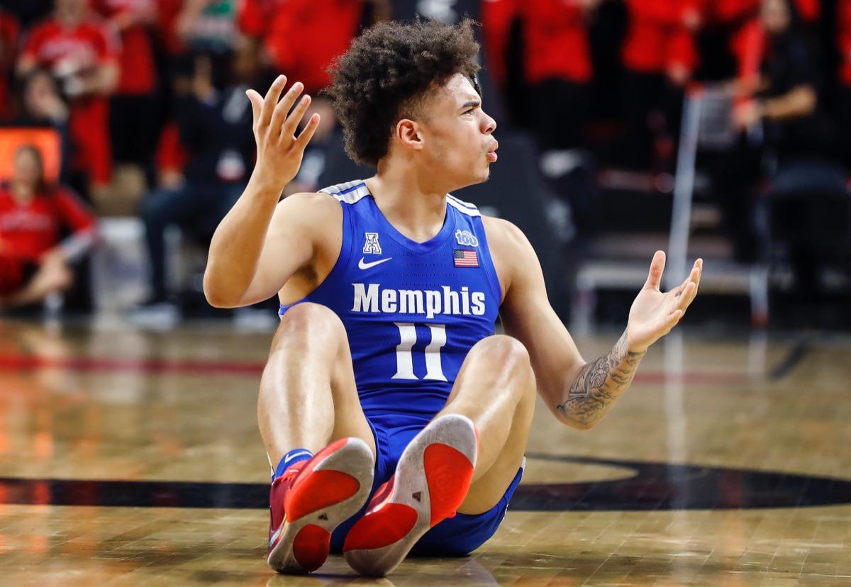 <strong>Memphis guard Lester Quinones looks to an official to call a foul against Cincinnati Thursday, Feb. 13, 2020.</strong> (Mark Weber/Daily Memphian)