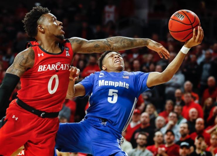 <strong>Memphis guard Boogie Ellis (right) drives the lane against Cincinnati's Chris McNeal (left) Thursday, Feb. 13, 2020.</strong> (Mark Weber/Daily Memphian)