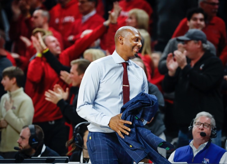 <strong>Memphis head coach Penny Hardaway smiles while taking off his jacket after an official's call against the Tigers while playing Cincinnati Thursday, Feb. 13, 2020.</strong> (Mark Weber/Daily Memphian)