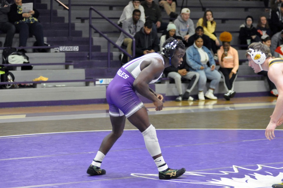 <strong>Ndayambje John prepares to wrestle an opponent from Ottawa University Jan. 25 in Clarksville, Arkansas. John won the match by technical fall 22-7.</strong> (University of the Ozarks)