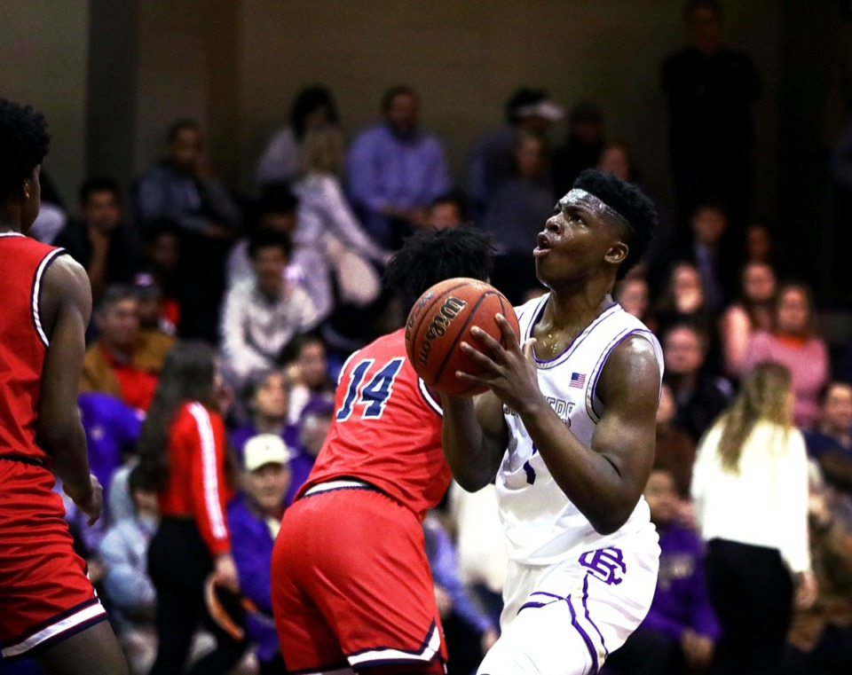 <strong>CBHS guard Chandler Jackson (1) goes in for a layup against St. Benedict Feb. 14, 2020.</strong> (Patrick Lantrip/Daily Memphian)