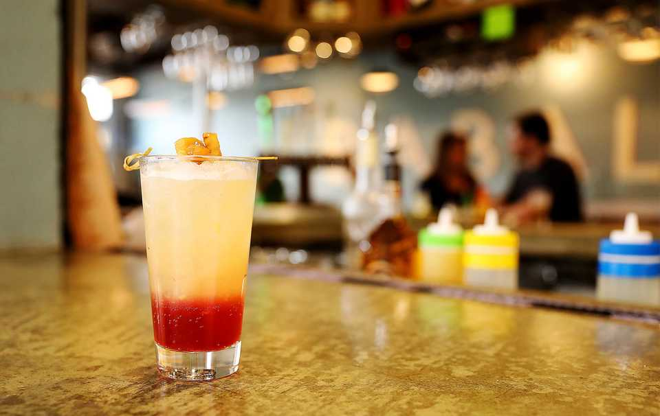 <strong>Babalu&rsquo;s Pineapple Upside Down Cake cocktail is made with grenadine, club soda, lemon and lime juice, a dash of salt, muddled pineapples, Licor 43 and Grey Goose vanilla vodka</strong>. (Patrick Lantrip/Daily Memphian)
