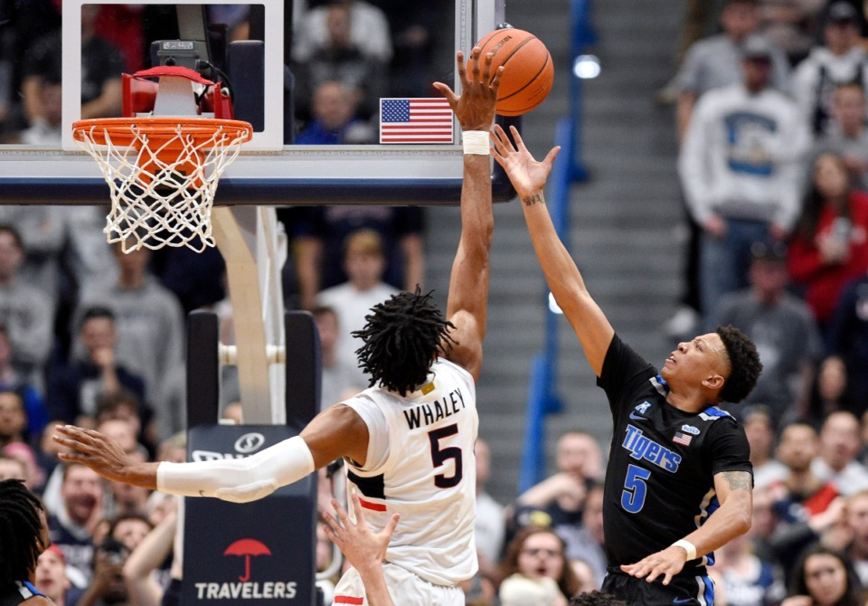 <strong>Connecticut's Isaiah Whaley (left), blocks a shot-attempt by Memphis' Boogie Ellis in the second half of an NCAA college basketball game, Sunday, Feb. 16, 2020, in Hartford, Conn.</strong> (Jessica Hill/AP)
