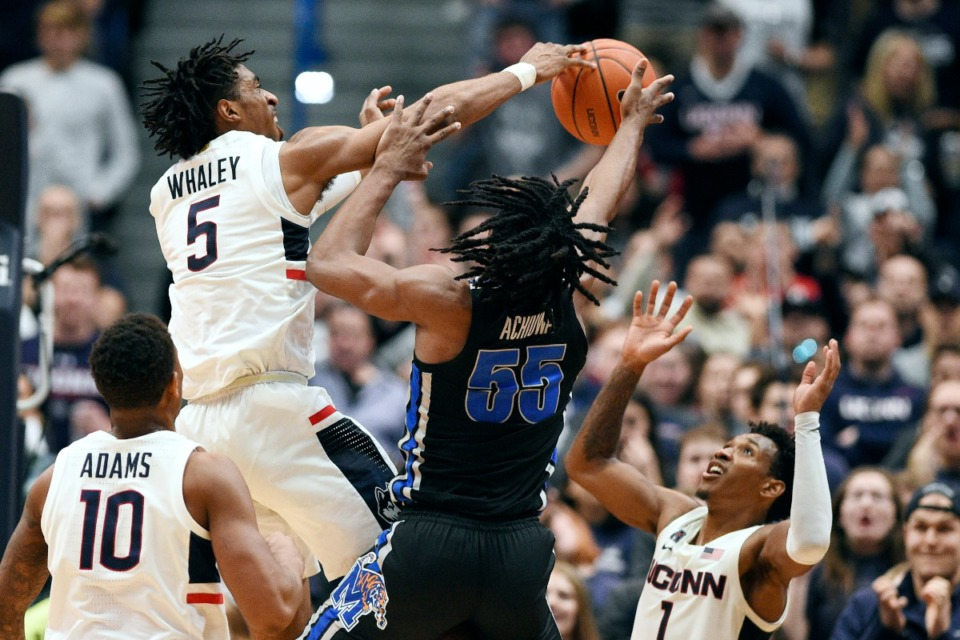 <strong>Connecticut's Isaiah Whaley (5) blocks a shot attempt by Memphis' Precious Achiuwa (55) during the second half of an NCAA college basketball game Sunday, Feb. 16, 2020, in Hartford, Conn.</strong> (Jessica Hill/AP)