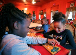 <strong>Michelle Wooten (left) and Jayla Leaks play a game while hanging out after school at Orange Mound Outreach Ministries on Thursday, Feb. 13. The ministry is home to a&nbsp;<span>teen grief pilot program started by the</span>&nbsp;<span>Shelby County Crime Victims &amp; Rape Crisis Center.&nbsp;</span></strong>(Patrick Lantrip/Daily Memphian)