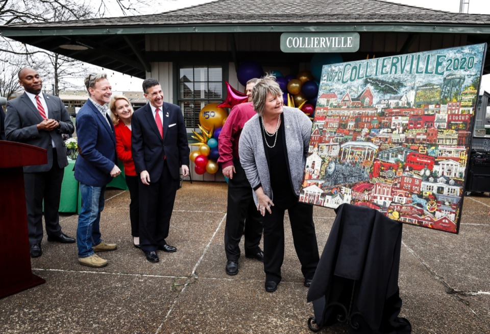 <strong>Local dignitaries unveil a painting that celebrates the town of Collierville's 150th anniversary during a party on Monday, Feb. 17, 2020 in Town Square.</strong> (Mark Weber/Daily Memphian)
