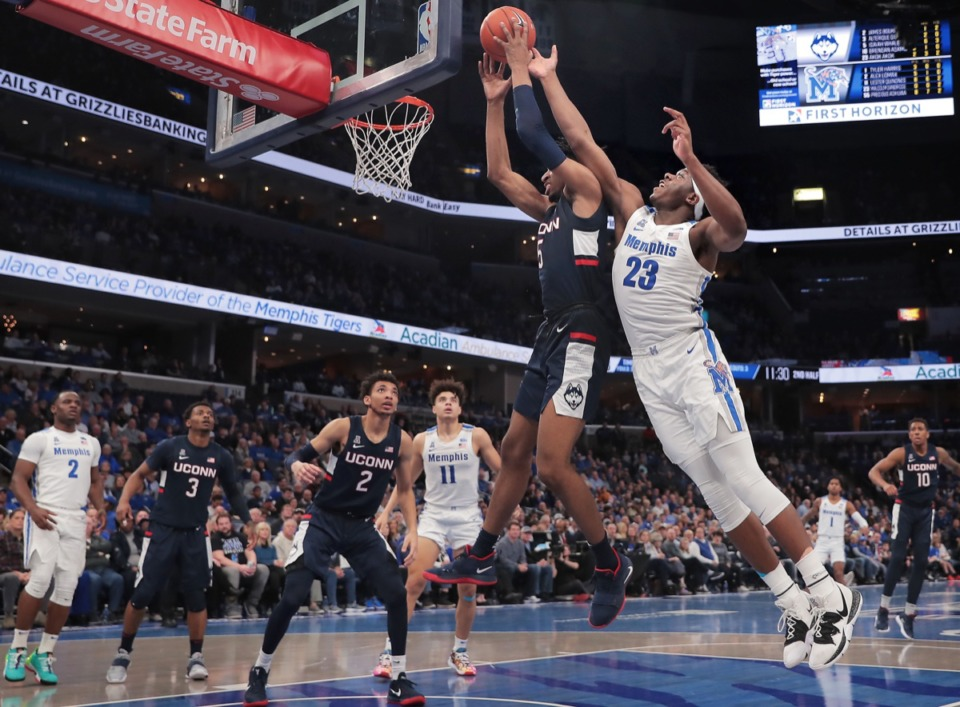 <strong>University of Memphis forward Malcolm Dandridge (23) battles for a rebound with the Huskies' Isaiah Whaley (5) Feb. 1 2020, at FedExForum.</strong>&nbsp;<strong>The game against UConn was another loss for the beleagured Tigers.</strong> (Jim Weber/Daily Memphian)