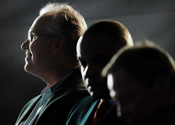 <strong>TVA president Bill Johnson (left) and MLGW president J.T. Young (center) listen as Memphis Mayor Jim Strickland speaks during a formal opening of the new Allen Combined Cycle Plant in southwest Memphis on Nov 11.</strong> (Jim Weber/Daily Memphian)