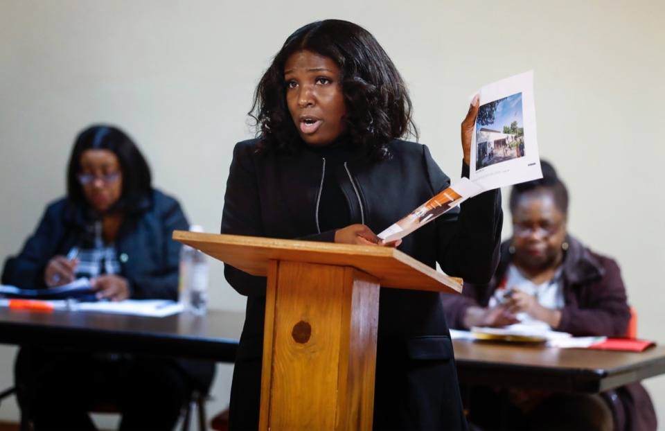 <strong>Councilwoman Michalyn Easter-Thomas holds up renderings of the new Ed Rice Community Center while speaking to residents during a Frayser Community Association meeting Monday, Feb. 17, 2020, at Word of Life Church.</strong> (Mark Weber/Daily Memphian)