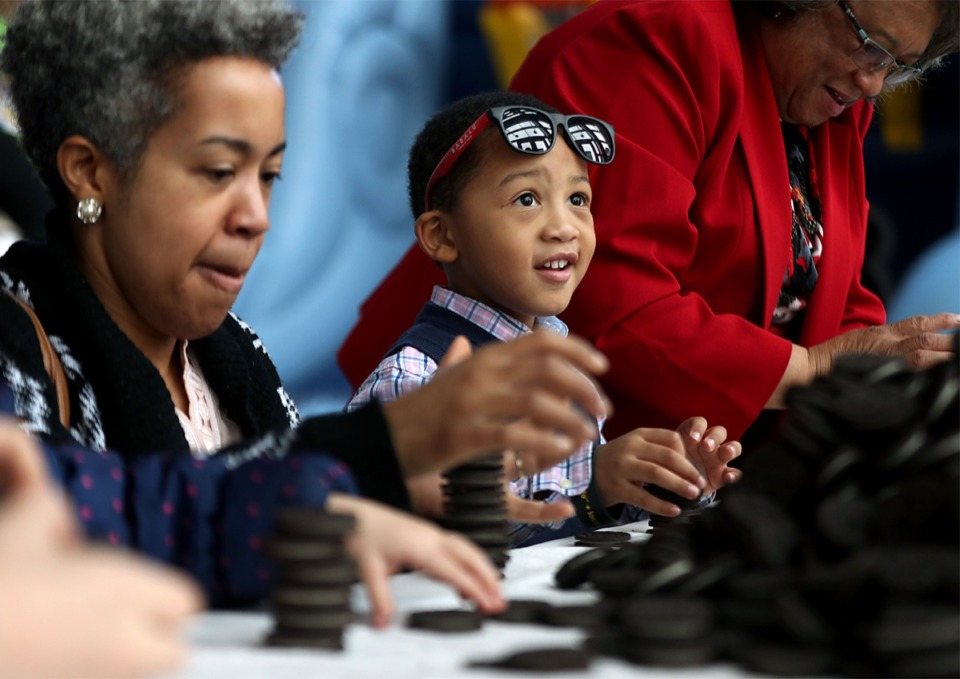 <strong>Gabriel Crivens competes in a friendly Oreo stacking contest with his mother Aisha and grandmother Irene Baker during last year's Soup Sunday at FedexForum Feb. 17, 2019.</strong> (Patrick Lantrip/Daily Memphian)