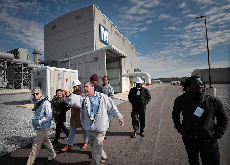 <strong>TVA maintenance coordinator George Czeiszperger (center) leads a tour of the new Allen Combined Cycle Plant in southwest Memphis for a group of MLGW employees on Nov 11 after a formal opening ceremony for the natural gas power plant.</strong> (Jim Weber/Daily Memphian)