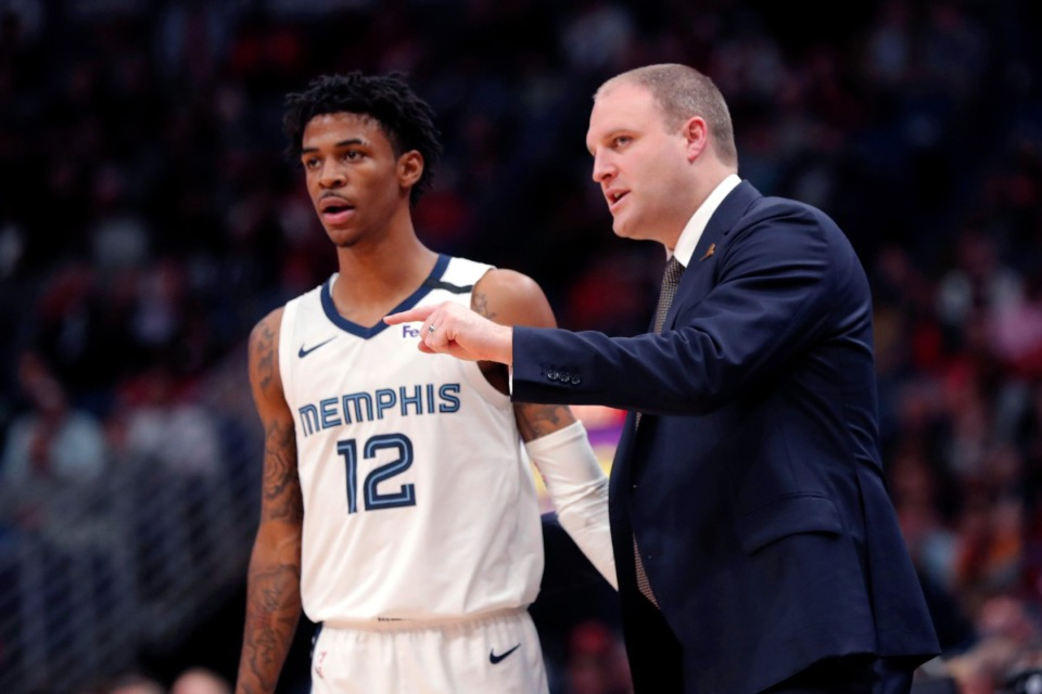 <strong>Memphis Grizzlies head coach Taylor Jenkins talks to Memphis Grizzlies guard Ja Morant (12) in the second half of an NBA basketball game against the New Orleans Pelicans in New Orleans, Friday, Jan. 31, 2020. The Pelicans won 139-111.</strong> (Gerald Herbert/AP)