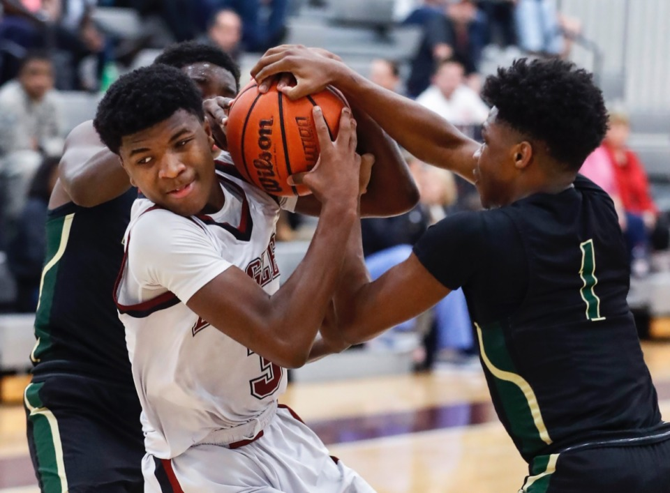 <strong>ECS guard Kameron Jones (left) battles for a loose ball with FACS defender Kobe Wilkes Jan. 14, 2020.</strong>&nbsp;<strong>Jones scored 39 points in his team's victory over Harding in the quarerterfinals of Division 2-A West Region tournament Feb. 18, 2020.</strong> (Mark Weber/Daily Memphian)