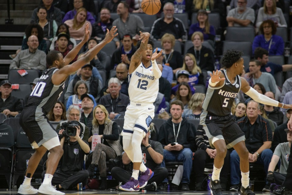 <strong>Grizzlies guard Ja Morant (12) passes the ball past Sacramento Kings forward Harrison Barnes (40) and Kings guard De'Aaron Fox (5) Jan. 2, 2020, in Sacramento, Calif.</strong>&nbsp;<strong>How will Morant and Fox match up in the season tie-breaker?</strong> (Randall Benton/AP)