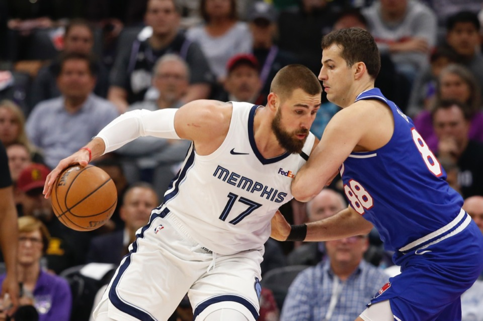<strong>Memphis Grizzlies center Jonas Valanciunas, left, drives against Sacramento Kings forward Nemanja Bjelica Feb. 20, 2020.</strong> (Rich Pedroncelli/AP)
