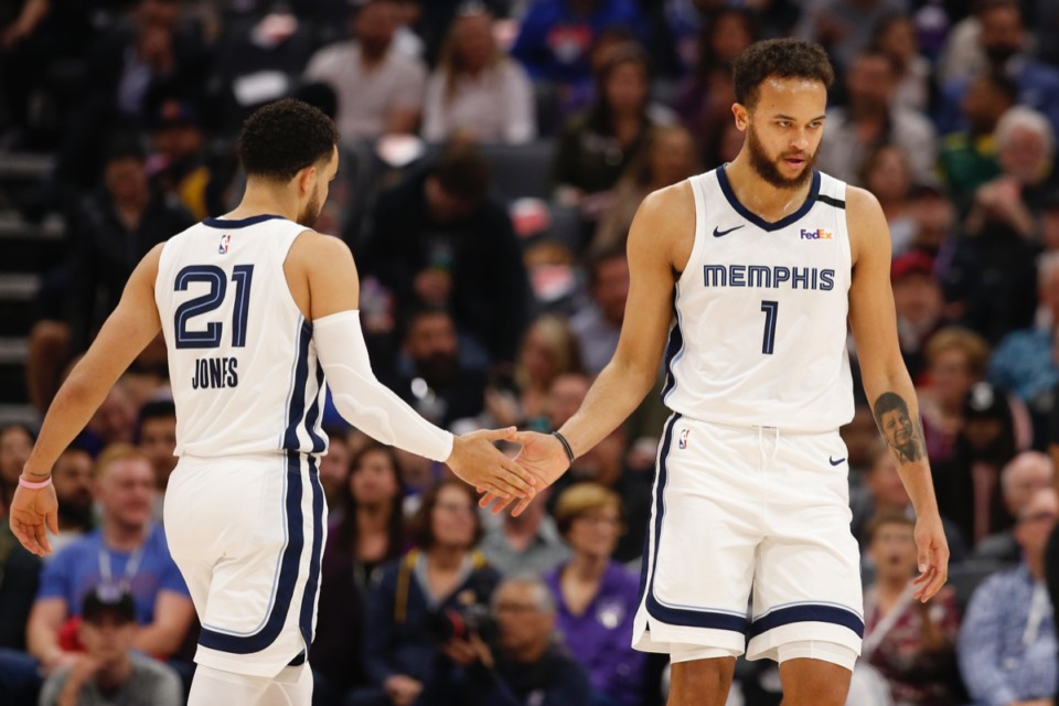 <strong>Tyus Jones, left, slaps palms with Kyle Anderson, right, as Anderson goes to the free-throw line against Sacramento Feb. 20, 2020.</strong> (Rich Pedroncelli/AP)