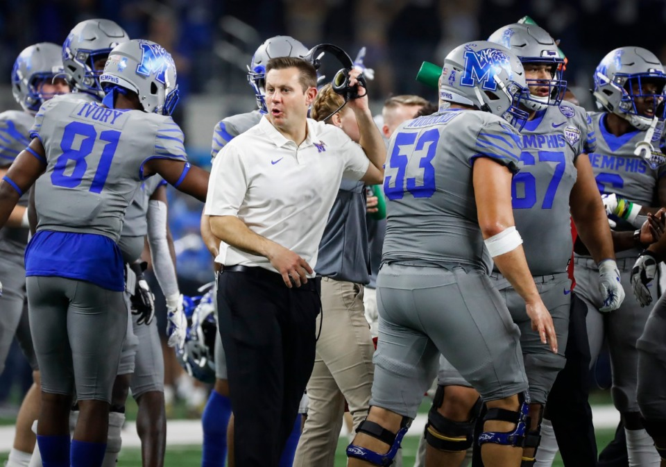 <strong>Memphis head coach Ryan Silverfield (middle) directs his players during a break in action against Penn State at the Cotton Bowl on Dec. 28, 2019 at AT&amp;T Stadium in Arlington, Texas.</strong> (Mark Weber/Daily Memphian)