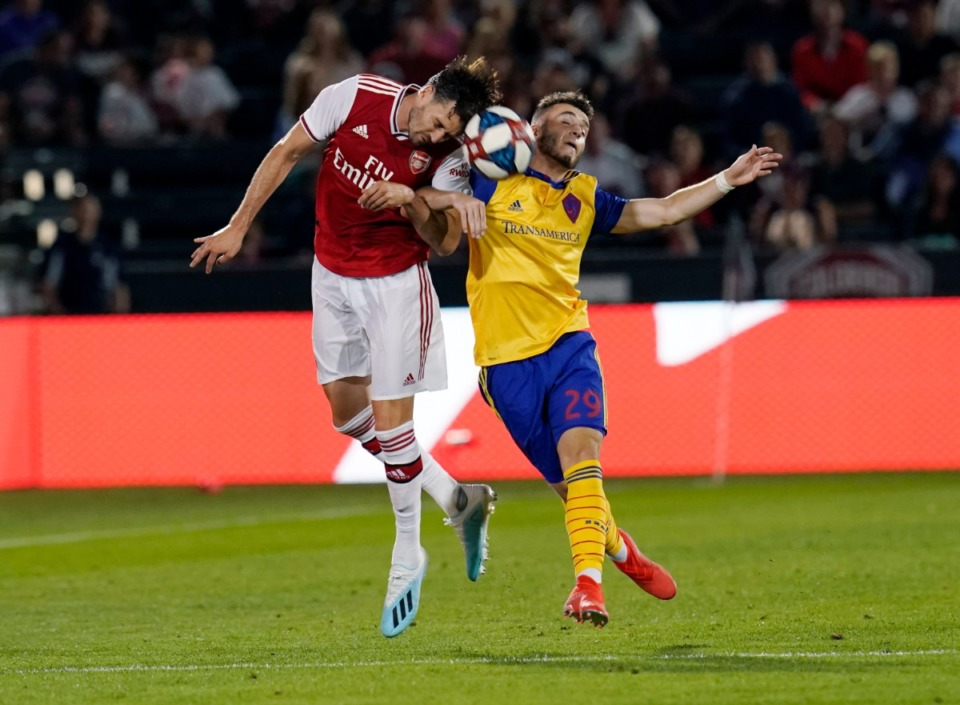 <strong>Arsenal defender Carl Jenkinson (25) heads the ball against Colorado Rapids forward Matt Hundley (29) during the second half of an international friendly soccer match, Monday, July 15, 2019.</strong> (AP Photo/Jack Dempsey)