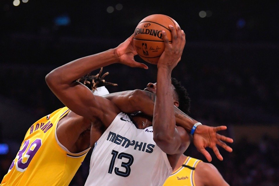 <strong>Los Angeles Lakers center Dwight Howard, left, fouls Memphis Grizzlies forward Jaren Jackson Jr. (13) in the act of shooting Feb. 21, 2020, in Los Angeles.</strong> (Mark J. Terrill/AP)