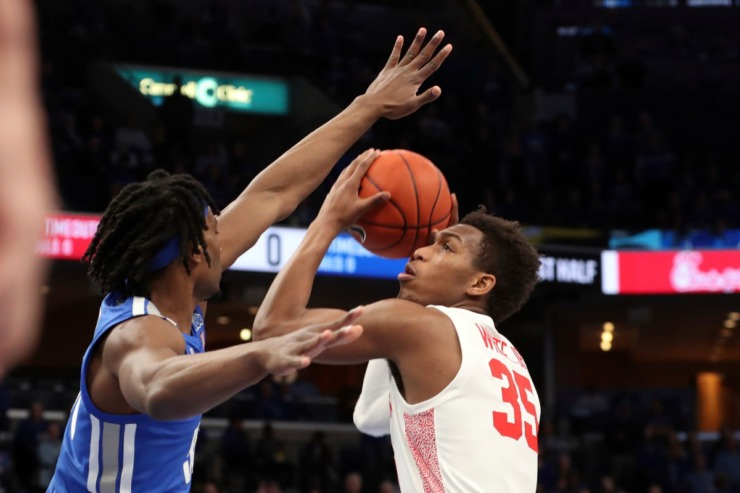 <strong>Houston forward Fabian White Jr. (right) goes up for a shot as Memphis forward Precious Achiuwa (left) defends in the first half of the Tigers game against Houston on Feb. 22, 2020, in Memphis.</strong> (AP Photo/Karen Pulfer Focht)