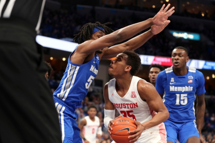 <strong>Houston forward Fabian White Jr. (35) goes up for a shot as Memphis forward Precious Achiuwa (55) defends in the first half&nbsp;of the Tigers game against Houston on Feb. 22, 2020, in Memphis. </strong>(AP Photo/Karen Pulfer Focht)