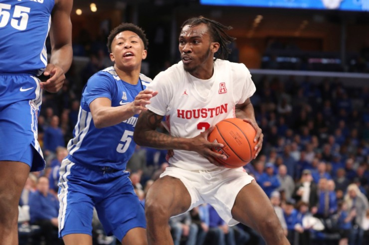 <strong>Houston guard DeJon Jarreau (3) looks to pass as Memphis guard Boogie Ellis (5) defends in the first half&nbsp;of the Tigers game against Houston on Feb. 22, 2020, in Memphis. </strong>(AP Photo/Karen Pulfer Focht)