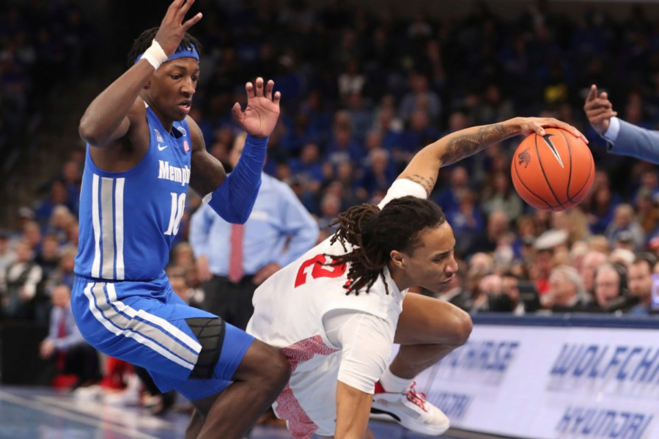 <strong>Houston guard Caleb Mills (2) gets tripped up on the court as Memphis guard Damion Baugh (10) defends in the first half the Tigers game against Houston on Feb. 22, 2020, in Memphis.</strong> (AP Photo/Karen Pulfer Focht)