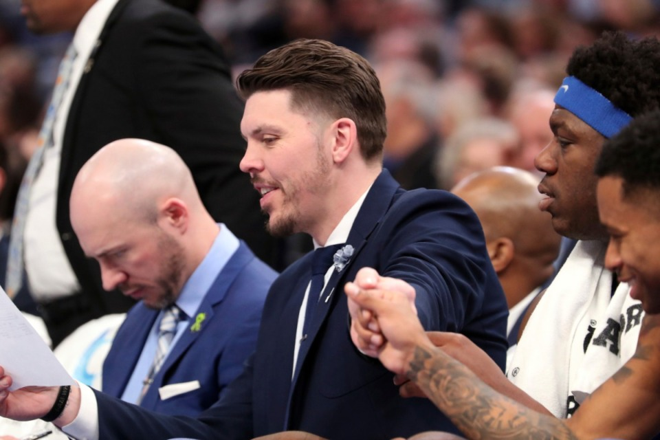 <strong>Memphis coach Mike Miller reaches out to player Tyler Harris (1) in the first half&nbsp;of the Tigers game against Houston on Feb. 22, 2020, in Memphis.</strong> (AP Photo/Karen Pulfer Focht)