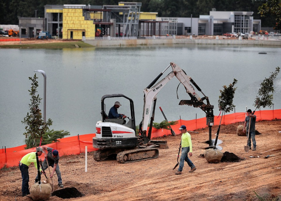 <strong>Construction crews work on landscaping near a new library and police precinct on Oct. 15, 2019, at the site of the old Raleigh Springs Mall.</strong>&nbsp; (Jim Weber/Daily Memphian file)