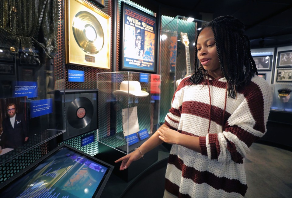 <strong>Memphis-based company Mind Over Data develops interactive exhibits for some of the country's premier museums. Blues Hall of Fame employee Jasmin Jackson shows one of their kiosks highlighting musician R.L. Burnside on Feb. 22, 2020. Jackson said she particularly enjoys the Burnside display at the Memphis museum because her uncle played drums for the famous bluesman.&nbsp;</strong>(Patrick Lantrip/Daily Memphian)