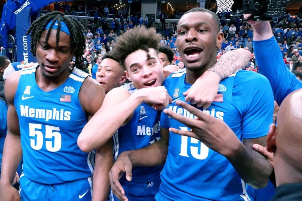 <strong>Memphis Tigers Precious Achiuwa (55), Lester Quinones (11) and Lance Thomas (15) celebrate after a win against Houston on&nbsp; Feb. 22, 2020, in Memphis.</strong> (AP Photo/Karen Pulfer Focht)