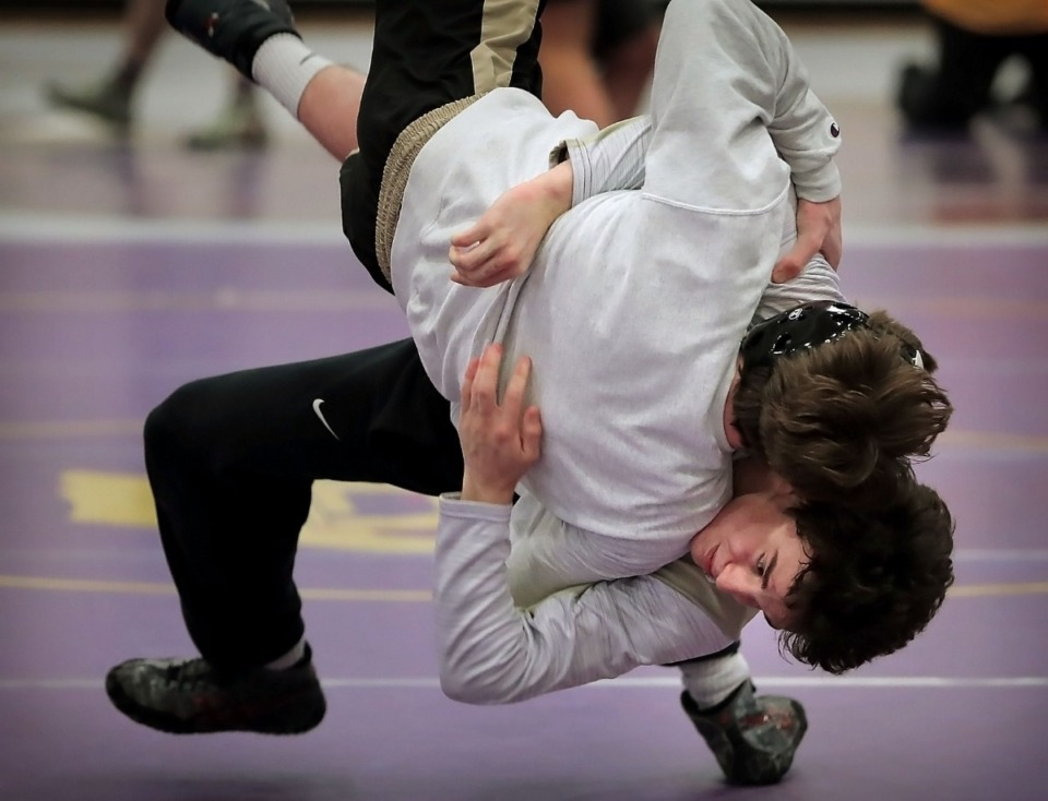 <strong>CBHS' Garrett Bowers works out with Evan Anthony on Feb. 12, 2020, at the Brothers Development Center as Christian Brothers gears up for the upcoming Division II regionals. Bowers won his third state title Saturday, Feb. 22, by defeating Lawrence Madson of Nashville Father Ryan in the Division 2 152-pound final.</strong> (Jim Weber/Daily Memphian)