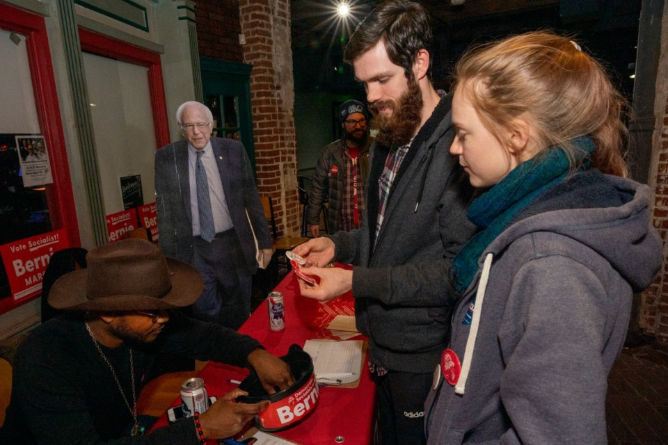 <strong>Jonathan Lifferth and Emily Lifferth select Bernie Sanders campaign buttons at the Bernie Fest fundraising event at Minglewood B-Side Saturday, Feb. 22, 2020.</strong> (Greg Campbell/Special to The Daily Memphian)