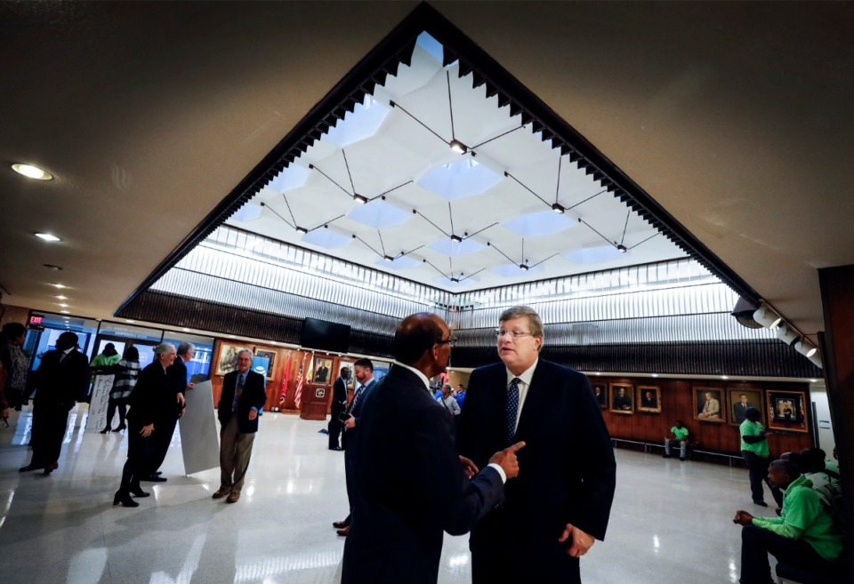 <strong>Mayor Jim Strickland (right) talks with Chuck Thomas, Regional Director of External Affairs at AT&amp;T,&nbsp; at City Hall Monday, Feb. 24, 2020. Renovations at City Hall will soon begin and include the roof in the Hall of Mayors that leaks on rainy days.</strong> (Mark Weber/Daily Memphian)