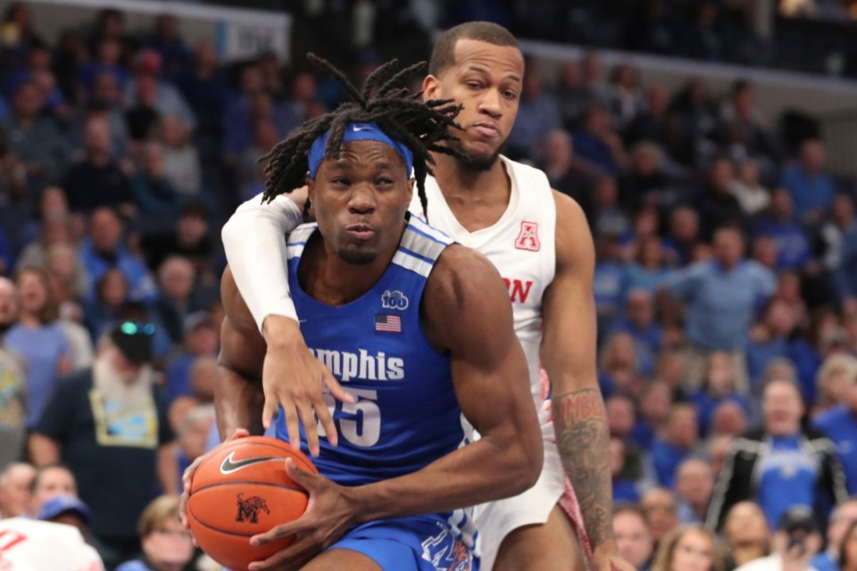 <strong>Memphis forward Precious Achiuwa (55) goes up for a basket as Houston forward Justin Gorham (4) defends in the second half of an NCAA college basketball game Saturday, Feb. 22, 2020, at FedExForum.</strong> (Karen Pulfer Focht/AP)