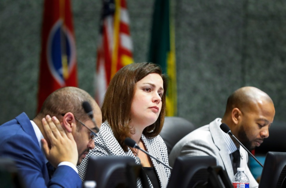 <strong>&ldquo;I think people should pay their fair share,&rdquo; said Commissioner Edmund Ford Jr. (left), who presented the ordinance. Eight commissioners including Amber Mills (center) and Mickell Lowery voted yes during the meeting Monday, Feb. 24, 2020.</strong> (Mark Weber/Daily Memphian)