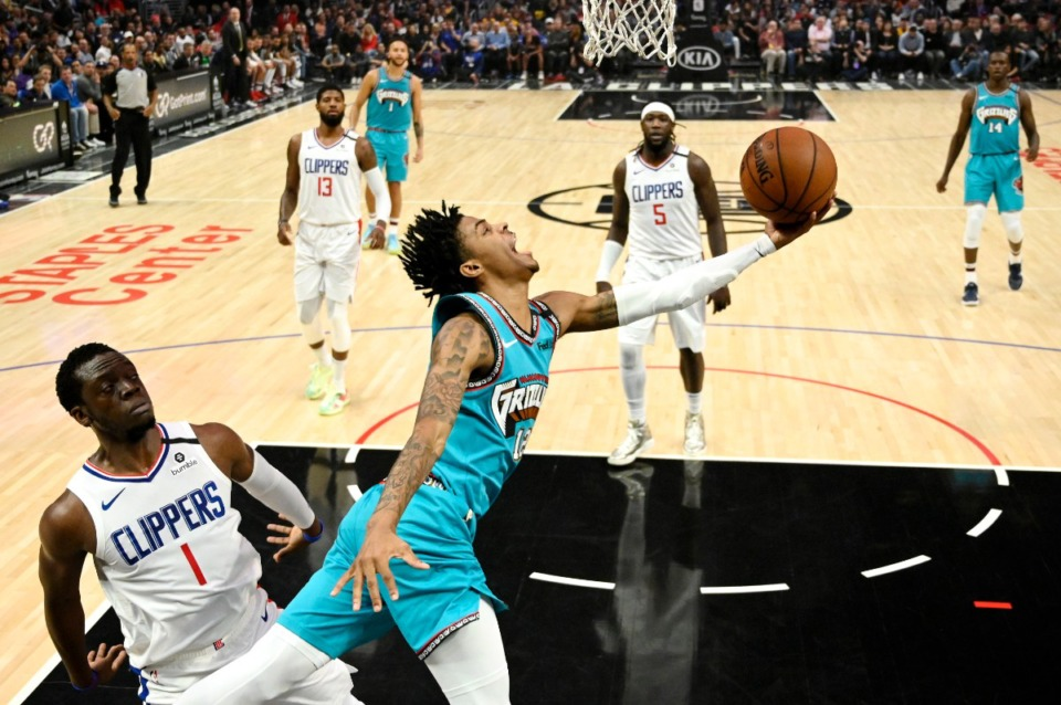 <strong>Memphis Grizzlies guard Ja Morant (12) shoots as Los Angeles Clippers guard Reggie Jackson (1) defends during the NBA basketball game Monday, Feb. 24, 2020, in Los Angeles.</strong> (Mark J. Terrill/AP)