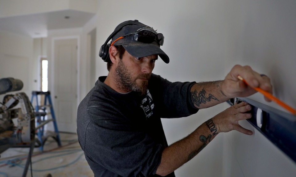 <strong>Bill Shennan and his company All-Trim Inc. put the finishing touches on a new house in the Winstead Farms subdivision of Lakeland, Tennessee, on Friday, March 29, 2019.</strong> (Patrick Lantrip/Daily Memphian file)