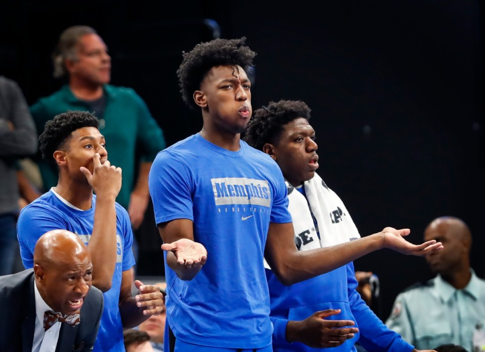 <strong>Former University of Memphis center James Wiseman (middle) watches action against Little Rock from the bench on Nov. 20, 2019, at FedExForum.</strong> (Mark Weber/Daily Memphian file)