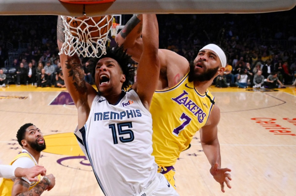 <strong>Memphis Grizzlies forward Brandon Clarke (center), dunks as Los Angeles Lakers center JaVale McGee (right), defends and forward Anthony Davis watches during the second half of an NBA basketball game Friday, Feb. 21, 2020, in Los Angeles. The Lakers won 117-105.</strong> (Mark J. Terrill/AP)