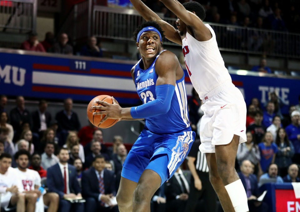 <strong>University of Memphis center Malcolm Dandridge (23) fights for a rebound during a road game against the Southern Methodist University Mustangs in Dallas Feb. 25, 2020.</strong> (Patrick Lantrip/Daily Memphian)