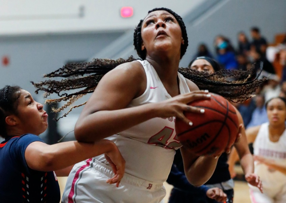 <strong>Houston forward Mallory Collier (right) grabs a rebound away from Ridgeway defender Amaya Mull (left) during action on Tuesday, Feb. 25, 2020 in Germantown.</strong> (Mark Weber/Daily Memphian)